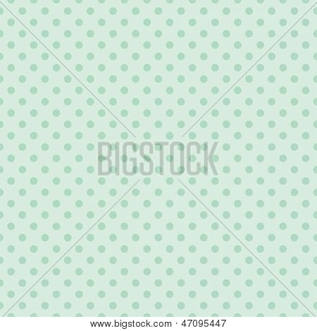Seamless vector pattern with dark green polka dots on a retro vintage mint green background.