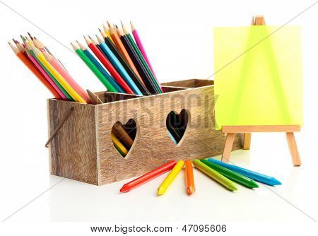 Different pencils in wooden crate and easel, isolated on white