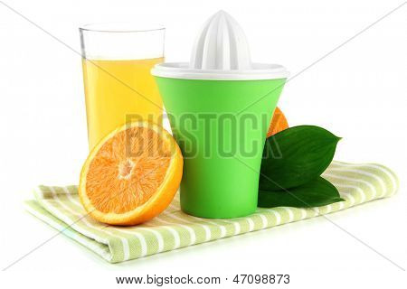 Citrus press, glass of juice and ripe oranges, isolated on white