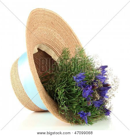 Bouquet of beautiful wild flowers in summer hat, isolated on white