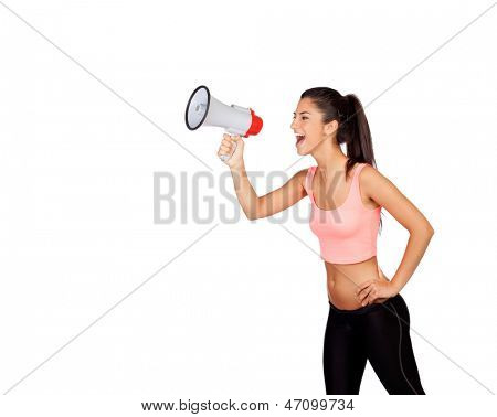 Attractive girl with fitness clothing and megaphone isolated on a white background