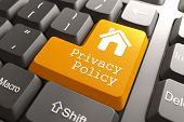 image of policy  - Orange Privacy Policy Button with Home Icon on Computer Keyboard - JPG