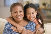 stock photo of pre-adolescent child  - Grandmother and daughter hugging - JPG