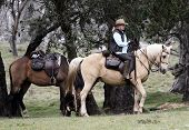foto of horse riding  - Female rider and horse in the Australian outback - JPG