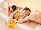 stock photo of all-inclusive  - picture of couple in spa salon lying on the massage desks - JPG