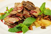 stock photo of roast duck  - Roasted sliced duck on dish in restaurant - JPG