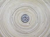foto of japanese coin  - Japanese Fifty Yen Coin on Bamboo Circular Tray - JPG