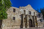 stock photo of texans  - Interesting Perspective of the Historic Alamo in the late Afternoon Sun - JPG