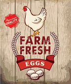 stock photo of farmer  - Retro Fresh Eggs Poster Design With Wooden Background - JPG