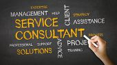 stock photo of slogan  - A person drawing and pointing at a Service Consultant Chalk Illustration - JPG
