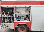 foto of fire brigade  - Part of equipment at one car of fire - JPG