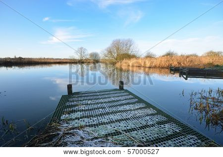 fishing platform jutting into river