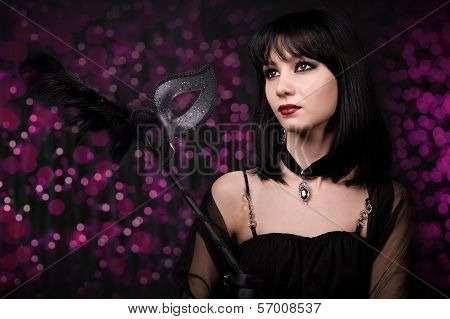 Beautiful Young Woman With Carnival Mask