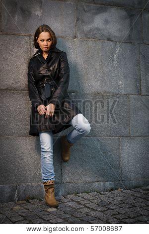 Beautiful Young Woman Near Stone Wall