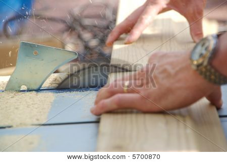 Close-up Of Carpenter Working With Table Saw