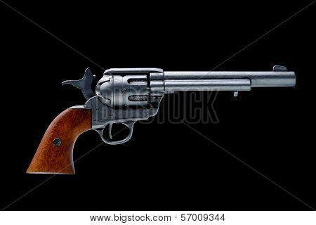 revolver pistol isolated on a black background