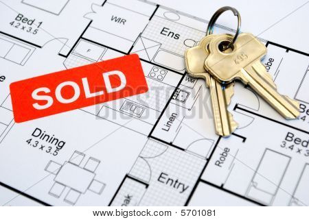sold sign with keys