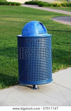 Blue Trash Can in park