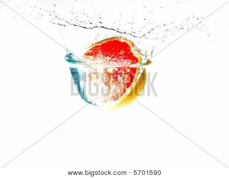 grapefruit falling into water