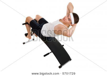 Young Man Exercise On Bench Working On Abdominal Muscles