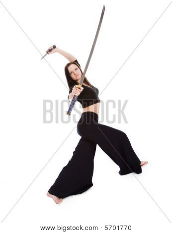 Beautiful Woman In An Aggressive Posture With A Sword  Katana