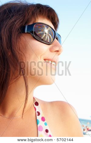 Woman With Glasses In The Sea