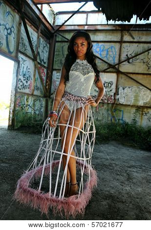 African American woman wearing swimgerie top and cage skirt
