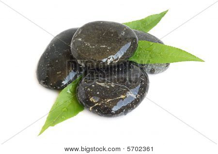 Spa Stones And Green Leaves