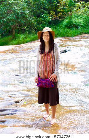 Biracial Teen Girl Standing In Shallow Water, Smiling