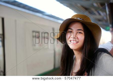 Smiling Teen Traveler Waiting For Train At Station