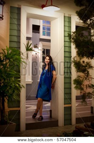Beautiful Teen Girl Standing In Doorway In Evening