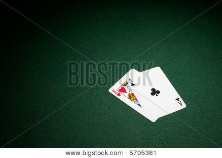 Blackjack Hand On Green Baize Table