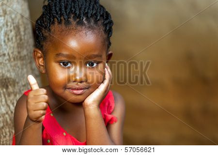 Cute African Girl Showing Thumbs Up.