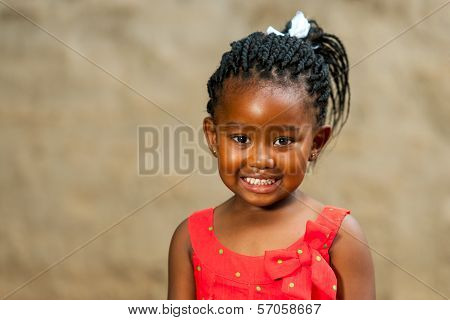 Little African Girl With Braided Hairstyle.