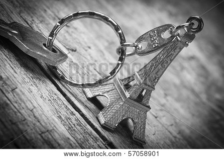 Keychain In The Shape Of The Eiffel Tower With Key Closeup.