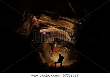 Spelunkers Exploring An Underground Cave
