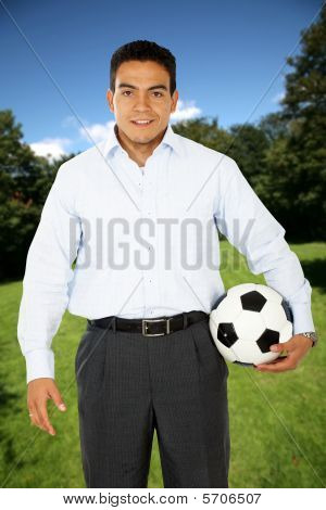 Man With A Football Outdoors