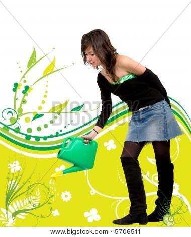 Girl Watering A Plant