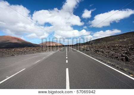 Empty Road Running Through Volcanic Landscape