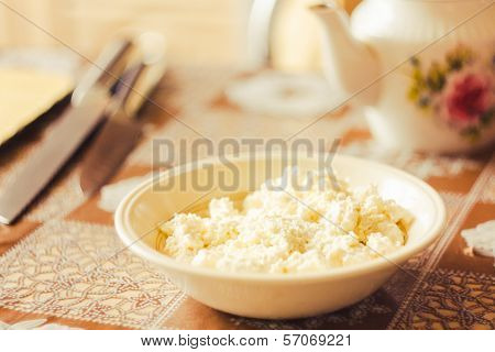 Cottage Cheese In Plate  On Table