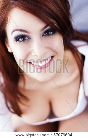 Beautiful Red-haired Girl Smiles.