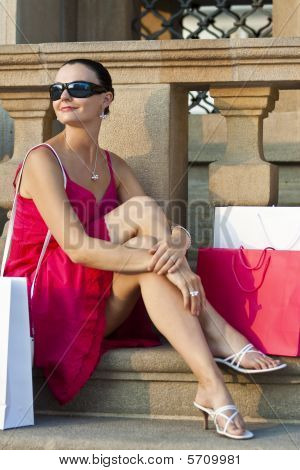 Beautiful Young Latina Woman Relaxing With Shopping Bags