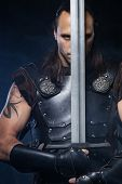foto of longsword  - Young man has some dangerous hobby - JPG