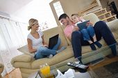 image of indoor games  - happy young family using tablet computer at modern  home for playing games and education - JPG