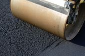 pic of scrap-iron  - Iron Road Roller leveling fresh asphalt pavement - JPG