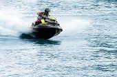 stock photo of jet-ski  - Man on jet ski jump on the wave - JPG