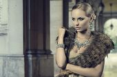 stock photo of aristocrat  - fashion portrait of luxury blonde girl posing with elegant hair - JPG