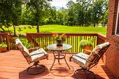 stock photo of ponds  - Backyard deck overlooking lake outside residential structure - JPG