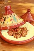 stock photo of tagine  - baeautiful terracotta tagine with meatbals and semollina - JPG