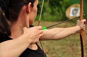 picture of longbow  - Young women training with the bow and arow  - JPG